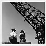 Dock workers and the Titan crane, by David Moore (7491554646).jpg