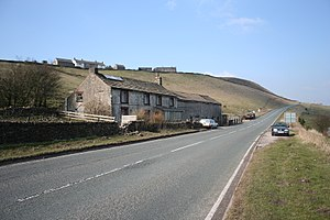 Axe Edge Moor - Dove Head Farm and the A53, looking towards Buxton. On the skyline are the cottages of Axe Edge End.