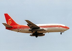 Cathay Dragon - Boeing 737-200 (VR-HYL) on final approach at Kai Tak Airport in original livery
