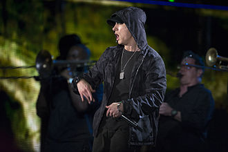 "Poodle Hat - The album's opening track is ""Couch Potato"", a parody of Eminem's (pictured) single ""Lose Yourself"". Although Eminem approved of the parody, he vetoed Yankovic's request to film a music video."