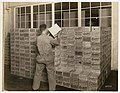 Employee working in the stockroom at Crescent Manufacturing Company, Seattle, circa 1923 (MOHAI 8604).jpg