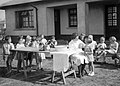 Evacuees from All Saints and Blackheath and Kidbrooke Schools, Greenwich, London attend a visit by a nurse at their new school at Penygroes, Carmarthenshire, Wales in 1940. D1047.jpg
