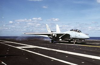 USS Saratoga (CV-60) - An F-14A of Fighter Squadron VF-74 catches the wire aboard Saratoga during the ship's 1985–86 Mediterranean cruise
