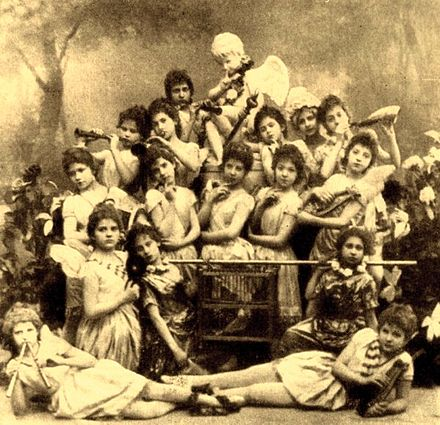 Students of the Imperial Ballet School in Marius Petipa's Un conte de fees. A ten-year-old Anna Pavlova participated in this work in her first ever ballet performance. She is photographed here on the left holding the birdcage. St. Petersburg, 1891. Fairy Tale - Students of the Imperial Ballet School. 1891.JPG