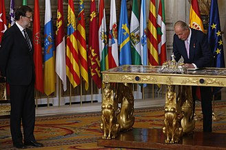 Government of Spain - King Juan Carlos I assenting to and enacting a law...
