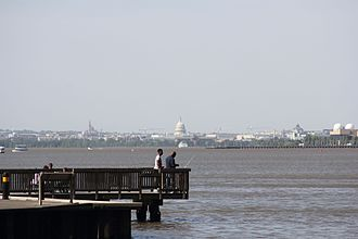Jones Point (Virginia) - Fishermen at Jones Point, Alexandria, Virginia, with the United States Capitol in the background