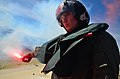 Flickr - Official U.S. Navy Imagery - An officer lights a flare during training..jpg