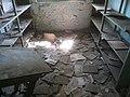 Floor and shelves at former Stara Gradiska Prison.jpg