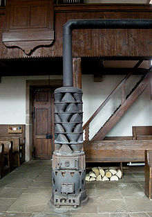 stove with large exhaust gas heat exchanger , in Fouday church