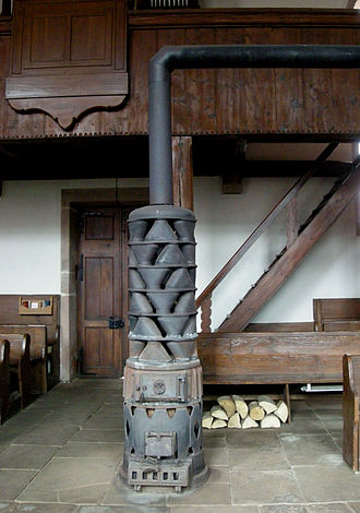 Stove - Alsatian stove with large exhaust gas heat exchanger, in Fouday church.