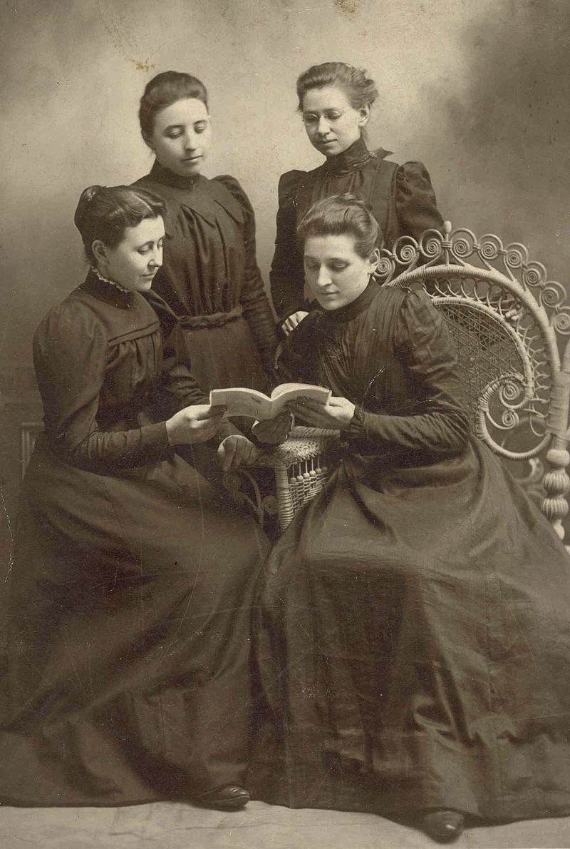 Four Elkhart Institute Ladies with Book, undated (11467224905).jpg