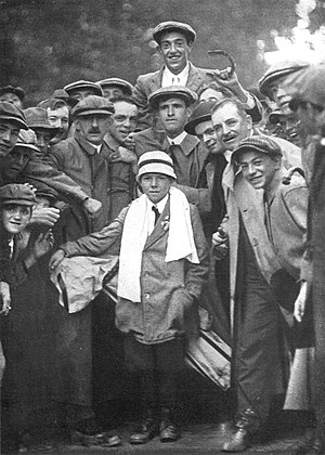 1913 U.S. Open (golf) - 1913 winner Francis Ouimet holding a horseshoe; with Eddie Lowery his 10-year-old caddy, with a white towel around his neck