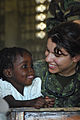 Friendly Canadian medic examines a smiling Haitian earthquake survivor.jpg