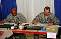From left, U.S. Air Force Tech. Sgt. Kurt Wells and Staff Sgt. Robert Shearer, both with the 375th Comptroller Squadron (CPTS), take a financial management instruction test as one of more than 150 scenarios 110724-F-ZP572-219.jpg