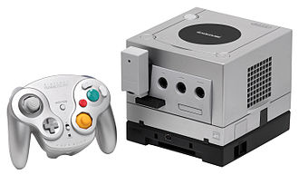 GameCube - A Platinum GameCube with a WaveBird controller and Game Boy Player attachment
