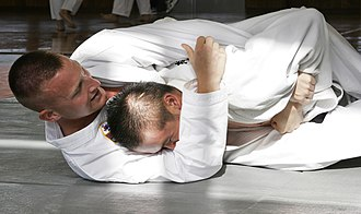 Grappling - In judo, the aim of ne-waza is to obtain a chokehold, joint lock or to pin the opponent.