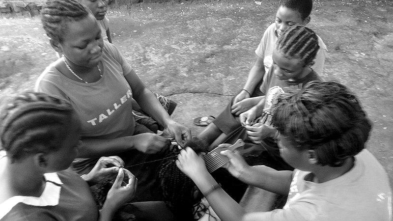 File:Girls braiding hair in Uganda.jpg