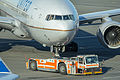 Goldhofer pushback tractor with a United Airlines plane at San Francisco International Airport-0724.jpg