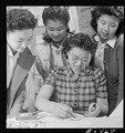 Granada Relocation Center, Amache, Colorado. A closeup of textile work. Yasko Taniguchi (seated) i . . . - NARA - 539299.tif