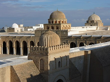 Domes of the Great Mosque of Kairouan. Founded in 670, it dates in its present form largely from the Aghlabid period (9th century). It is the oldest mosque in the Maghreb. Great Mosque of Kairouan, flat roof and domes.jpg