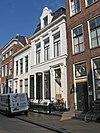 foto van Eenvoudig huis met omlijste ingang (Makelaardij Groningen)