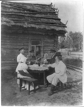1875 in Russia - Group of Russian peasants posed at an outdoor table LCCN2001705716