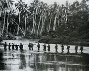 A US Marine patrol crosses the Matanikau River in September 1942.