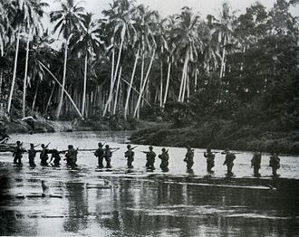 Actions along the Matanikau - A U.S. Marine patrol crosses the Matanikau River on Guadalcanal in September 1942