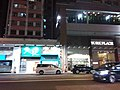 HK 灣仔 Wan Chai 莊士敦道 Johnston Road sidewalk shop night July 2019 SSG 01.jpg