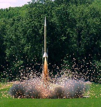 High-power rocketry - A high-power rocket lifting off.