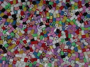 Close-up of a bucket full of midi-sized Hama b...
