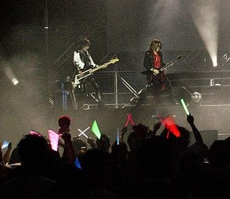 Sugizo - Heath and Sugizo during an X Japan concert in Hong Kong, 2009.