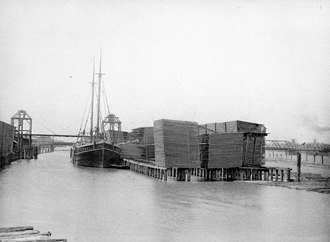 Saginaw, Michigan - Holland Lumber Docks on Saginaw River 1888