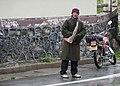 Huanglong Sichuan China Man-with-fur-bag -01.jpg