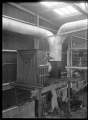 Hutt Railway Workshops at Woburn. Interior view with new heating apparatus, 1929. ATLIB 290013.png
