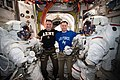 ISS-60 Andrew Morgan and Nick Hague with their spacesuits in the Quest airlock.jpg