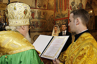 Roman Pontifical - A server holding the Archieratikon for a Russian Orthodox Patriarch of Moscow.