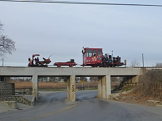 Indiana Rail Road - Maintenance equipment traveling on the tracks of the Indiana Rail Road in Bloomington, IN
