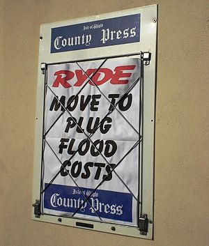 A headline board for the Isle of Wight County ...