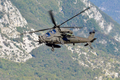 Italian Army Aviation A-129D attack helicopter with a Spike anti-tank guided missile during an exercise 2020.png