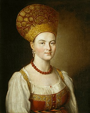 Kokoshnik - The portrait of an unknown girl in the Russian costume by Ivan Argunov, 1784, showcasing a large kokoshnik head dress on a bald Muscovy girl.