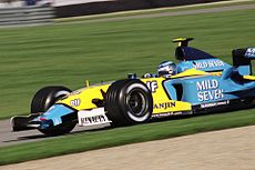 Jarno Trulli driving for Renault at the United States Grand Prix at Indianapolis in 2003.