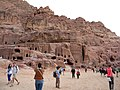 Jordan, Petra. Facades with double-crowsteps frieze in the outer Siq, next to the theater. (tourists).jpg