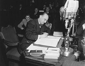 Mr. Joseph Smallwood signing the agreement whi...