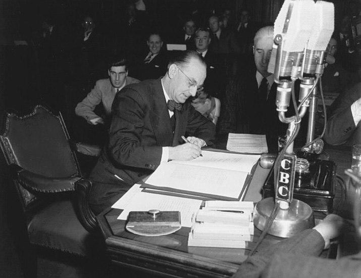 Joseph Smallwood signing Newfoundland into Confederation