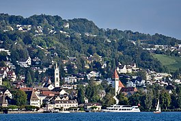 Küsnacht and Küsnachter Tobel, as seen from ZSG ship MS Helvetia on Zürichsee in Switzerland