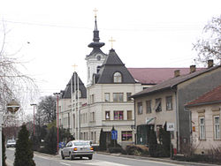 Kać, Main street and the Orthodox Church.jpg
