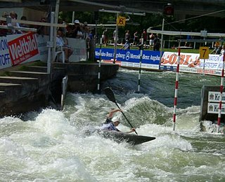 Canoe slalom discipline in sport of canoeing and kayaking, to navigate through a course of hanging gates on river rapids