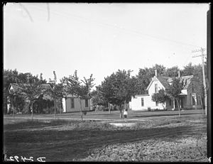 Kearney, Nebraska - Streets of Kearney, Nebraska showing houses and one person, c. 1907