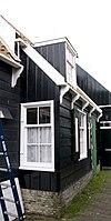 foto van Perceelsgedeelte van een houten huis